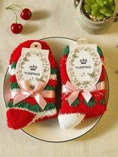 Kalėdinės kojinės, paruoštos dovanai